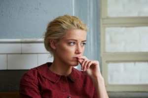 Amber Heard's character does a lot of worrying in this movie, but look and the simple pastel palette that is used on her eyes and mouth.