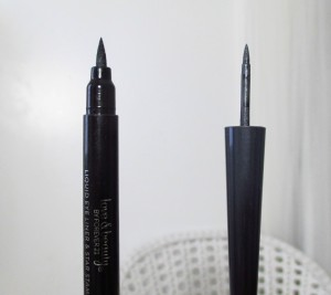 An inky black marker type liquid liner, verses a brush on liquid grey liner...